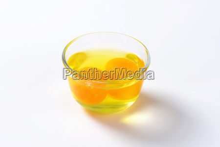 egg whites and yolks in glass