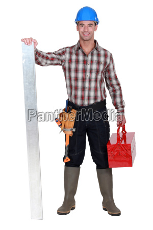 manual worker stood with tool box