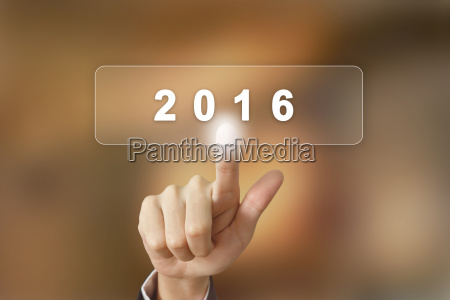 business hand clicking 2016 happy new
