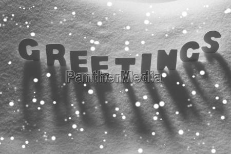 white word greetings on snow snowflakes