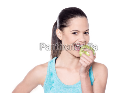 young fit woman having an apple