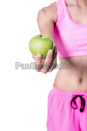 woman holding green apple cropped