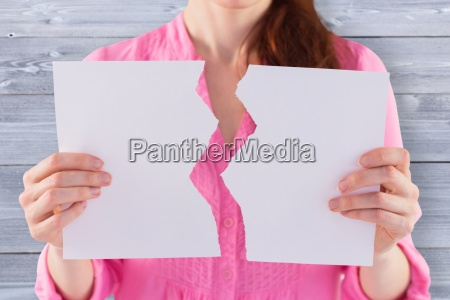 composite image of woman holding torn