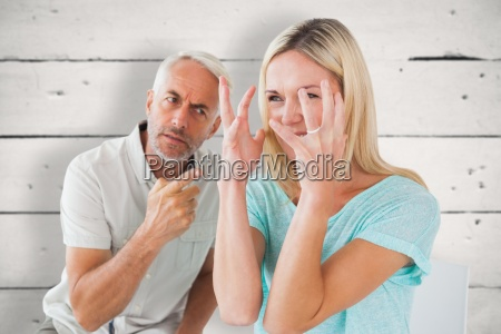 composite image of unhappy couple sitting