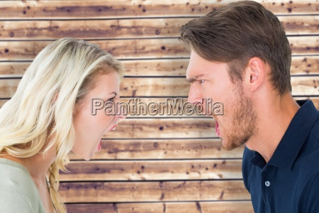 composite image of angry couple shouting