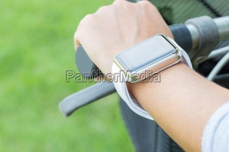 closeup hand wear smart watch riding