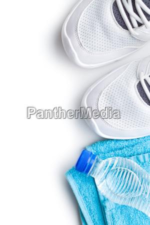 sport concept bottle shoes and towel