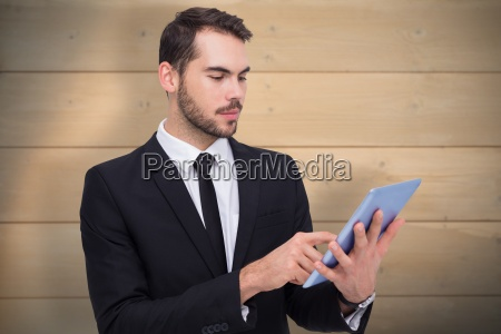 composite image of cheerful businessman touching