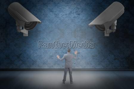 composite image of businessman standing with