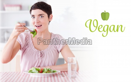 vegan against charming woman eating salad