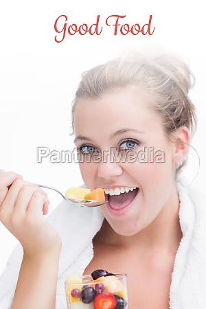 good food against woman eating fruit