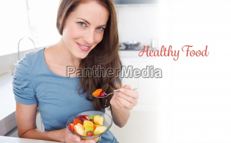 healthy food against smiling young woman