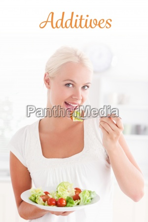 additives against woman eating a salad
