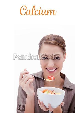 calcium against woman eating fruit salad