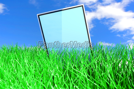 tablet pc in the grass