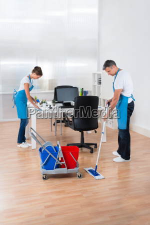 cleaners with cleaning equipments cleaning the