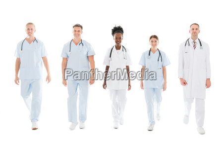 confident multiethnic medical team walking in