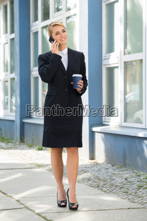 businesswoman using mobile phone during lunch