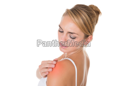 woman suffering from shoulder pain