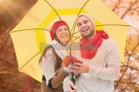 composite image of autumn couple holding