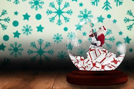 santa rocking out in snow globe