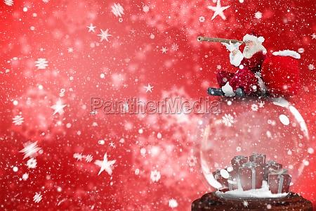 composite image of santa sitting on