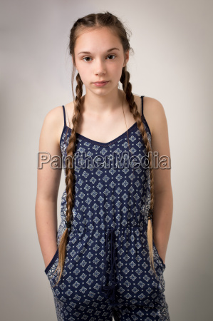 beautiful teenage girl with plaits and