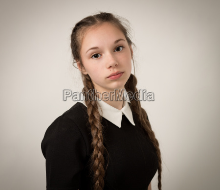 beautiful teenage girl with plaits dressed