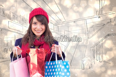 composite image of smiling brunette opening