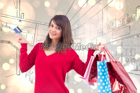 composite image of brunette holding gift
