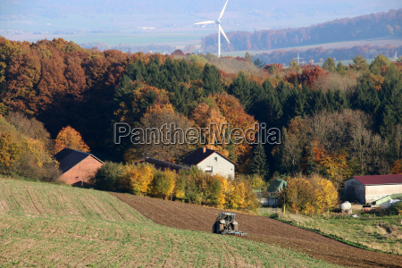 autumn landscape with tractor