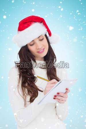 composite image of festive brunette writing