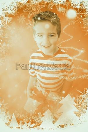 composite image of festive little boy