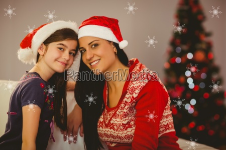 composite image of festive mother and