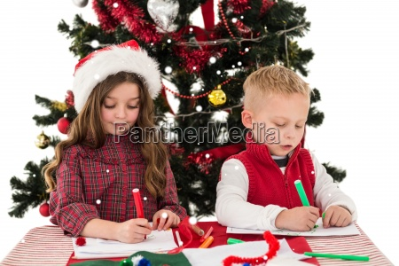 composite image of festive little siblings