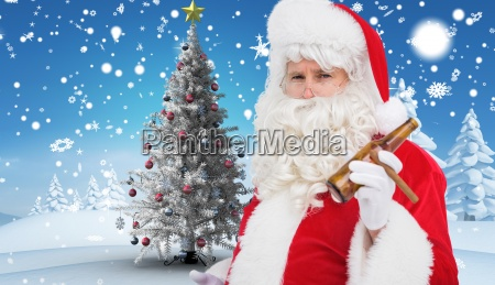 composite image of santa claus holding