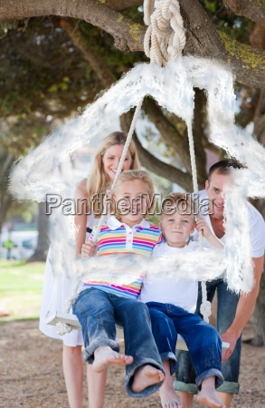 composite image of happy parents pushing