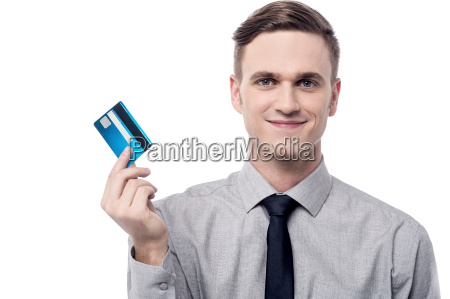 handsome salesman showing credit card