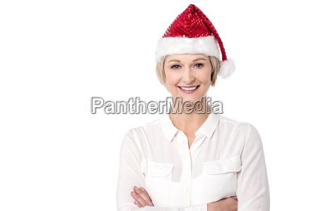 arms crossed cheerful lady wearing santa