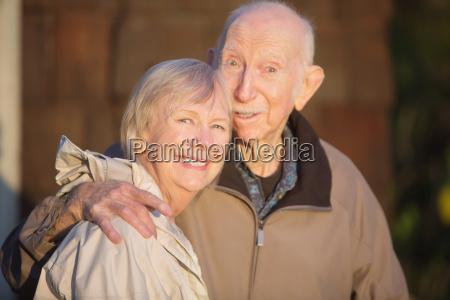 smiling senior couple outdoors