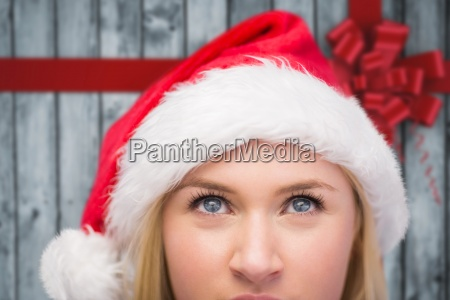 composite image of festive blonde looking