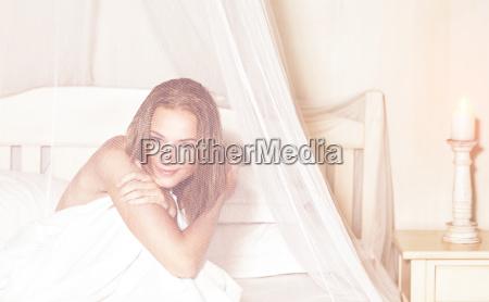 gentle female in the bedroom