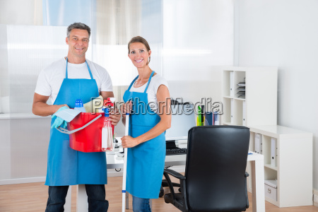 two cleaners with cleaning equipments