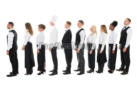 side view of restaurant staff standing