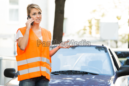 woman using mobile phone with broken