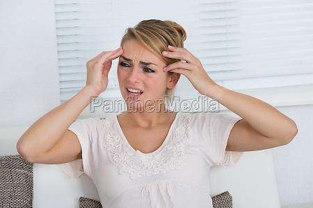 portrait of woman suffering from headache