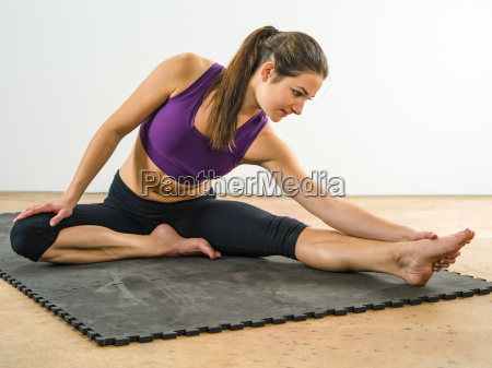 attractive woman stretching her legs