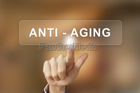 business hand clicking anti aging button