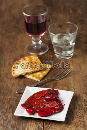 greek peppers with wine on wood