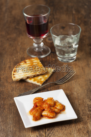 greek beans with wine on wood